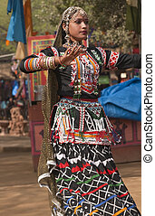 Dancing girl - Female kalbelia dancer in traditional tribal...