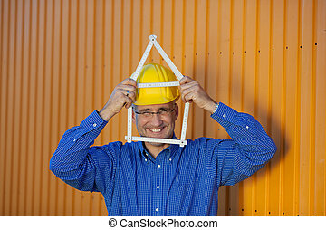 Architect Holding House Frame Against Trailer - Portrait of...