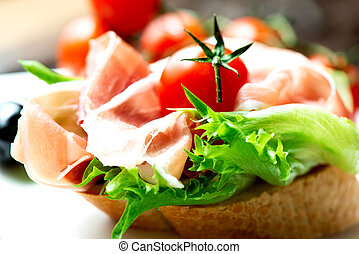 Sandwiches with prosciutto on plate macro - Sandwich with...