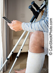 Man with Injury Making a call - Young Man with Injury...