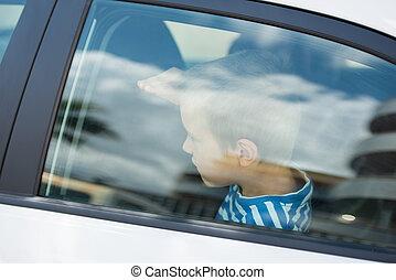 Little guy in car - Close up portrait of little guy inside...