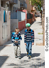 School children - Portrait of two kids walking on the way to...