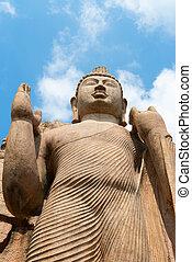 Avukana standing Buddha statue, Sri Lanka. 40 feet (12 m)...
