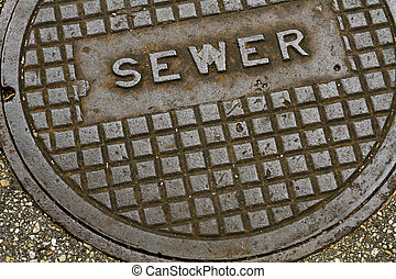 Steel Sewer Manhole Cover Lid - An old grungy steel metal...