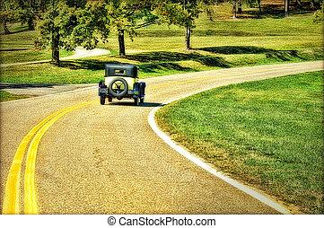 Antique Car - faux HDR image of an antique car driving down...
