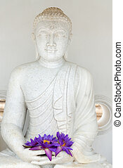 Buddha image statue with fresh flowers