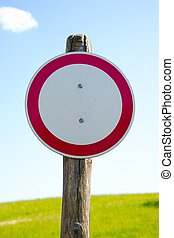No Entry - No entry sign in front of a green field