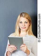 Young Blond Businesswoman Using Digital Tablet