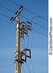Electric line - Electric pillar against clear blue sky