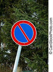 No parking traffic sign in front of trees