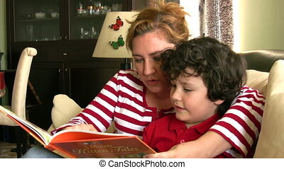 Mother reading with her son - Bonding between mom and son