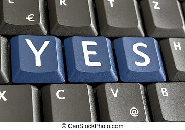 YES written on computer keyboard - Word YES written with...