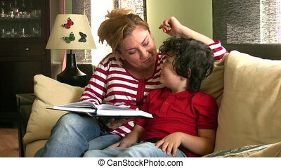 Reading time - Mother and son reading picture book