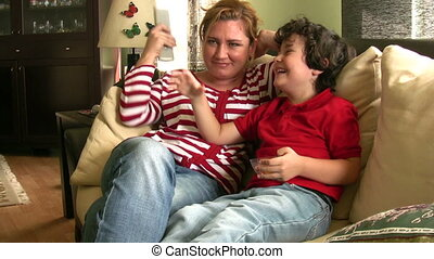 Mother and son having fun - Mom and son watching tv