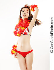 Shapely Asian Woman in Red Bright Swimsuit with Origami. Fashion Style
