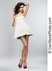 Minimalism. Fashion Style. Stylish Woman in Light White...