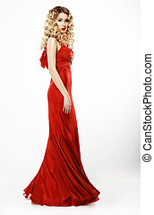 Luxury. Full Length of Elegant Lady in Red Satiny Dress....