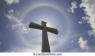 Crucifix Cross with Halo Sun Flare Timelapse with Moving...