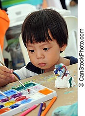 Child painting - Child 2 years painting in preschool