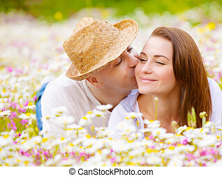 Two lovers on floral meadow - Two happy lovers laying down...