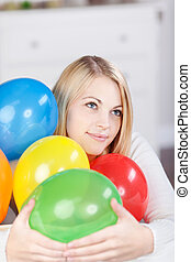 Young Thinking Woman With Colorful Balloons - Portrait of...