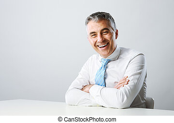 Business man smiling - Portrait of a handsome mature man...