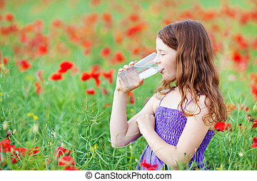 Drinking water - Young Caucasian girl drinking a glass of...