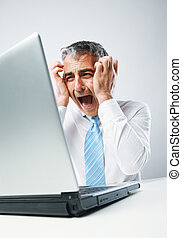Stressed Out Businessman - Stressed business man sitting at...