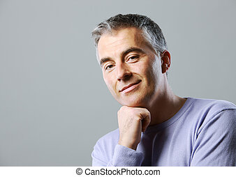 Mature man - Portrait of casual man smiling on grey...