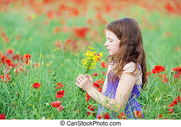 Little girl smelling a bunch of flowers - Pretty little girl...
