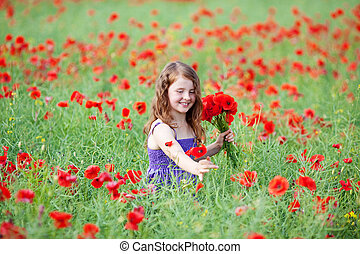 Beautiful little girl picking red poppies - Beautiful little...