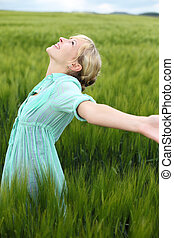 Beautiful woman rejoicing in the summer standing in long...