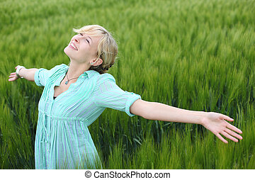 Happy woman - Portrait of young happy woman in a cornfield