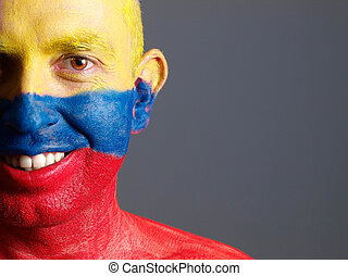 Man face painted with colombian flag, smiling expression -...