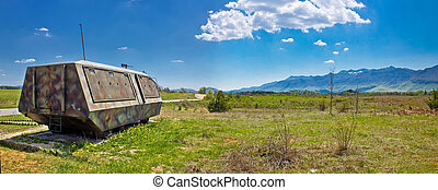 Lika nature scenery and armoured military vehicle, Velebit...