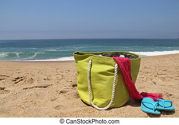 Beach items on the shore - Beach items on the seashore and...