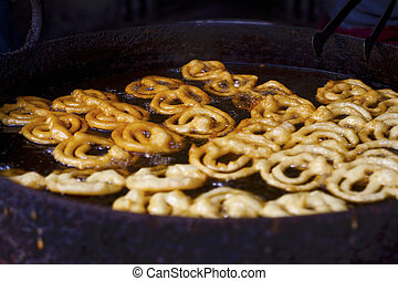 Cooking famous Indian sweet jalebi