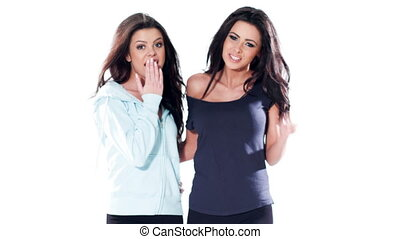 Two Brunette Girls in Casual Clothes Posing Isolated on...