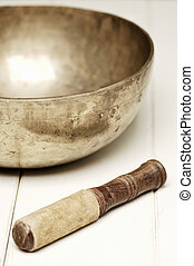 singing bowl on a white table, selective focus