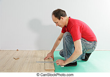 Guy in red measuring plank
