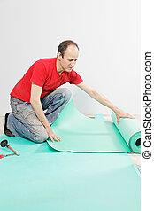 Guy examining mat