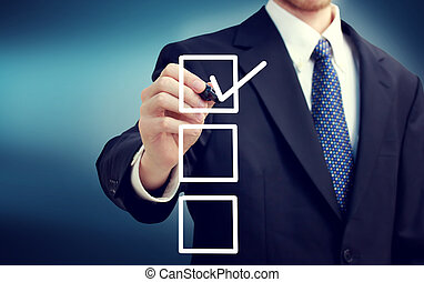 Business man with checkboxes over blue background