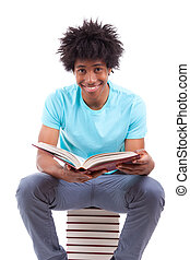 Young black teenage student men reading a books, isolated on...