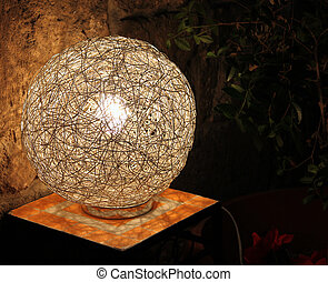 Outdoor Wire Lamp - A modern lamp made from intertwined...