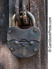 old lock - big old lock keeps this door shut