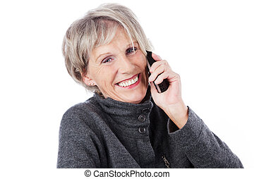 Smiling elderly woman on the telephone