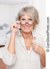Elderly lady with reading glasses