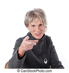 Senior woman pointing at the viewer - Attractive grey haired...