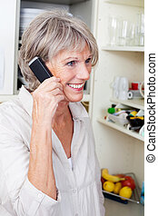 Trendy older woman talking on the phone