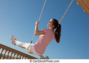 teen girl on swing